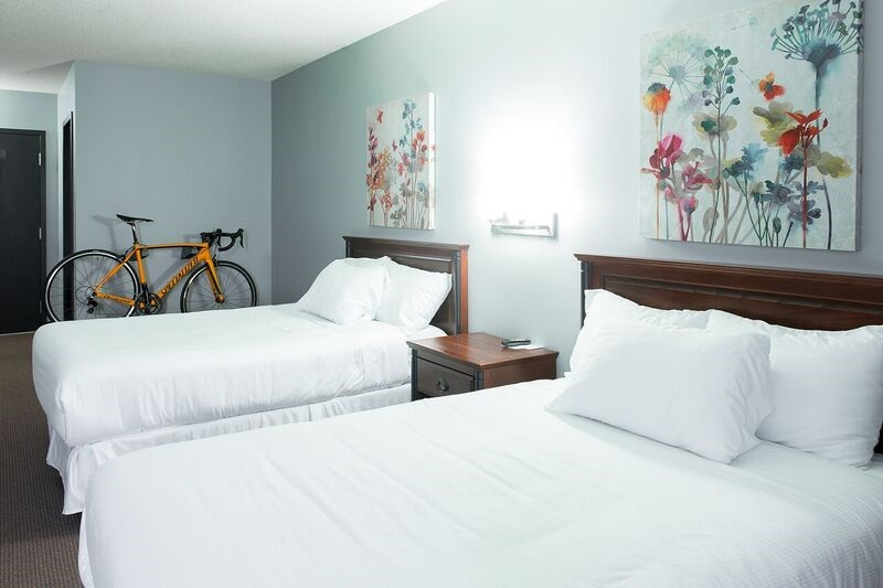 http://notrehotel.ca/wp-content/uploads/sites/2/2014/10/Chambre-support-Vélo-2.jpg