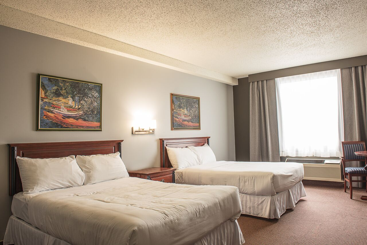 http://notrehotel.ca/wp-content/uploads/sites/2/2014/10/Chambres-aoñt-2015-3.jpg